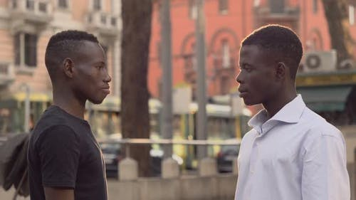 young smiling African men greeting in the street. Friendship, ethnicity