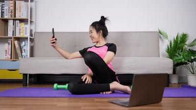 Woman trainer video call with smartphone