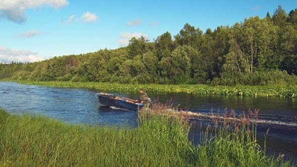 Cover Image for Motor Boat Floats on River in Forest