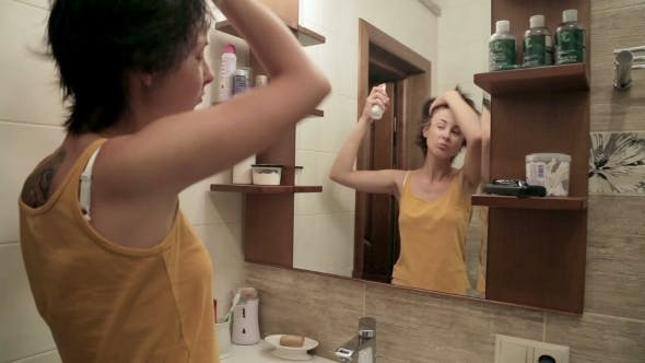 Thumbnail for Young Woman In The Bathroom