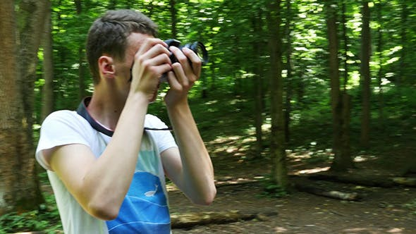 Thumbnail for Teen In Wilderness Area Taking Picture