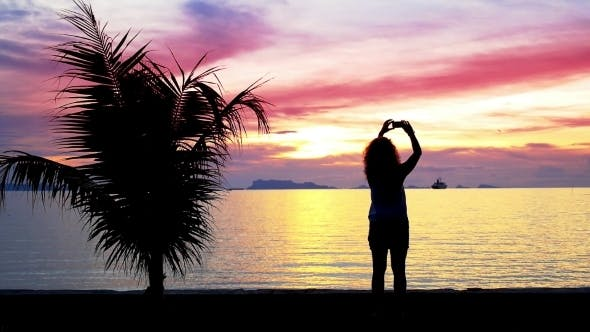 Thumbnail for Silhouette Of a Girl Photographs Beautiful Sunset
