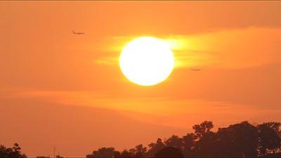 Setting Sun and Aeroplanes