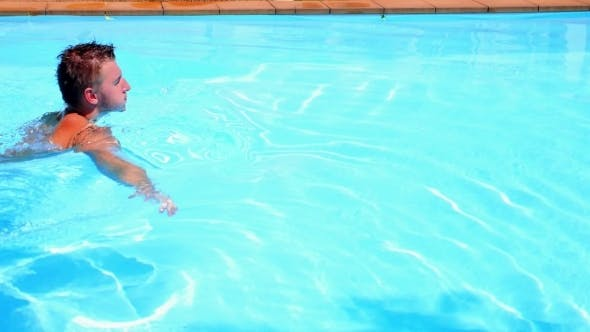 Thumbnail for Young Man Swimming In a Pool In Summer Villa