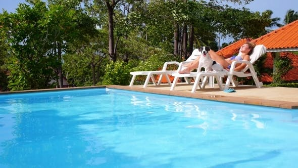 Thumbnail for Woman with Dog Sunbathing And Relaxing near Pool