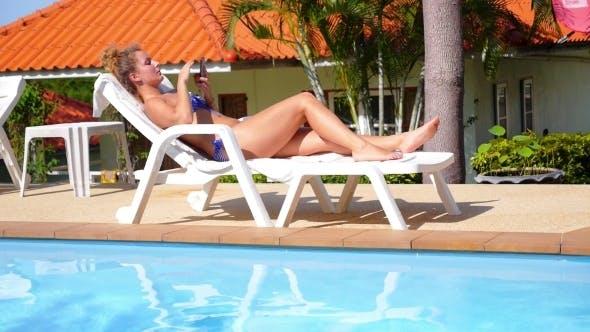 Thumbnail for Young Beautiful Woman In Bikini Relaxing On a