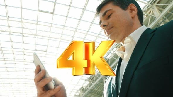 Thumbnail for Businessman With Smartphone In Modern Building