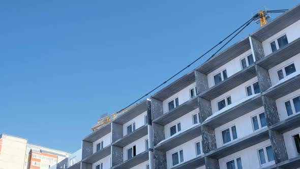 Thumbnail for Construction of a Multi-storey Building. Crane Turns To the Side Over the Roof.