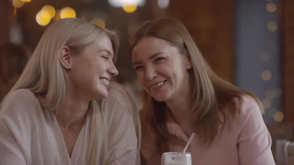 Thumbnail for Happy Mother and Daughter Enjoying Each Others Company in Cafe