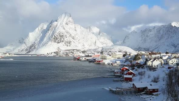 Thumbnail for Norwegian fishing town on the background of winter mountains