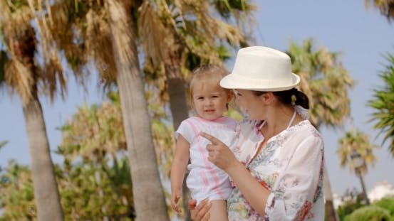 Thumbnail for Mom Carrying Her Little Daughter At The Resort