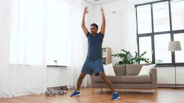 Thumbnail for Indian Man Doing Jumping Jack Exercise at Home