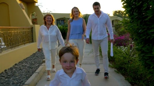 Thumbnail for Family Walking On Resort Area In The Evening