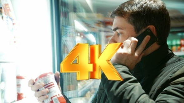 Thumbnail for Man Talking On The Phone In Food Store