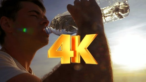 Thumbnail for Young Man Drinking Water Outdoor At Sunset