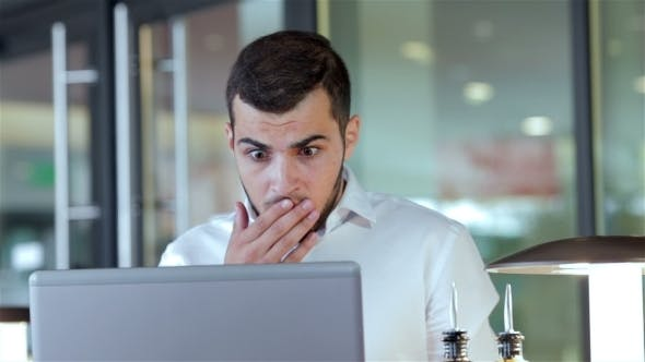 Cover Image for Young Man Having Some Problems With His Laptop