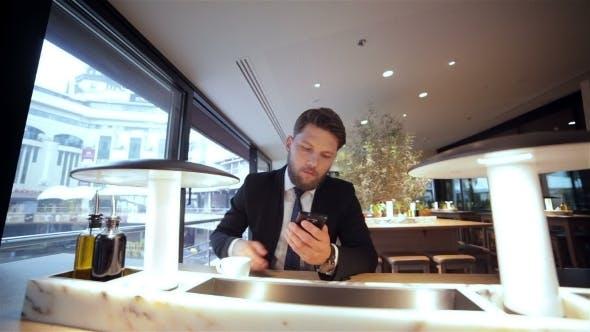 Businessman On a Break In Restaurant