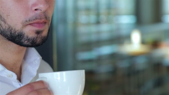 Thumbnail for Young Man Drinking Coffee