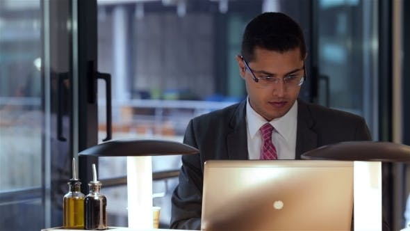 Thumbnail for Businessman Working With Laptop In Cafe