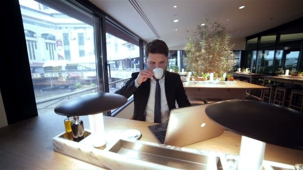 Cover Image for Businessman On a Break In Restaurant