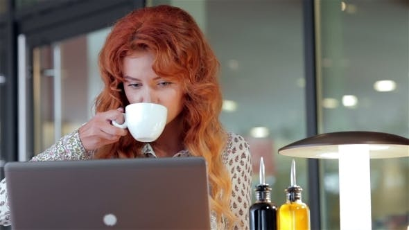 Thumbnail for Beautiful Girl Working With Her Laptop In Cafe