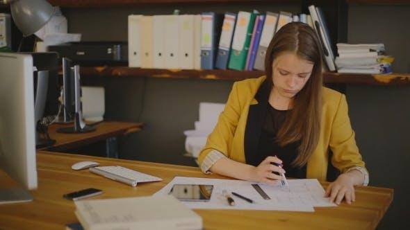 Thumbnail for Business Woman Architect Drawing Checks