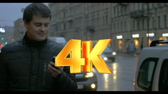 Thumbnail for Man With Cellphone In The Evening Rainy City