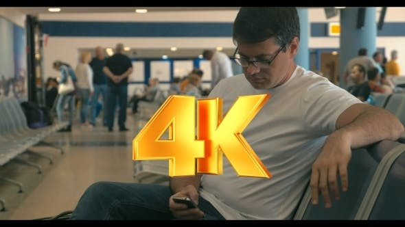 Thumbnail for Young Man Using Cell Phone In Airport Lounge