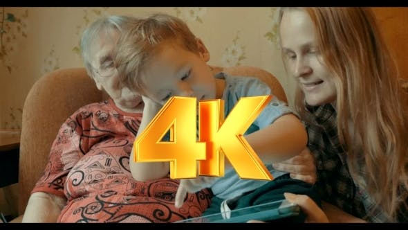 Thumbnail for Boy Playing On Pad With Mother And Grandmother