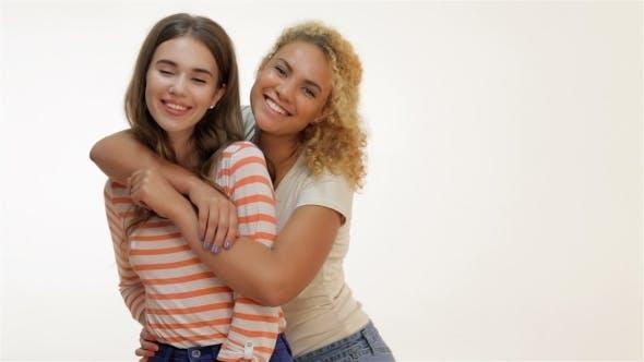 Thumbnail for Two Laughing Girls Hugging