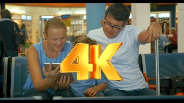 Thumbnail for Family Waiting For Departure With Tablet PC