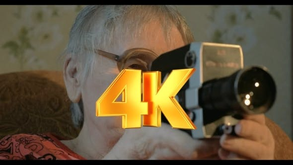 Thumbnail for Elderly Woman With Retro Camera At Home