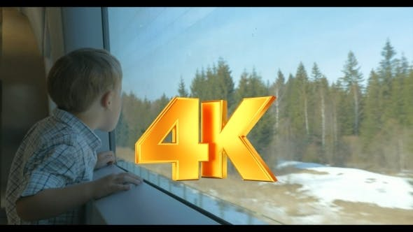 Thumbnail for Boy Looking At Nature Scene Through The Train
