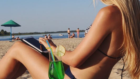 Thumbnail for Blonde Girl Using Tablet on the Beach