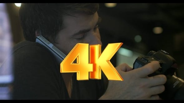 Thumbnail for Man Talking On Phone And Using Camera