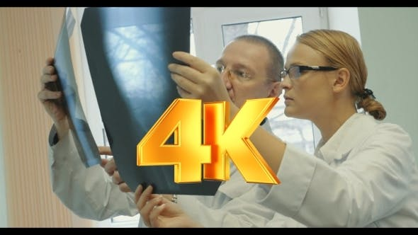 Thumbnail for Doctors Analyzing The Results Of X-ray Examination