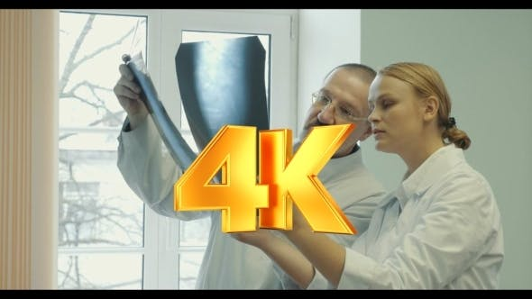 Thumbnail for Two Doctors Comparing X-ray Images