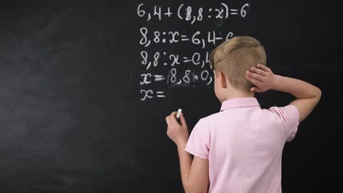 Schoolboy Trying to Solve Math Exercise Near Blackboard, Primary Education