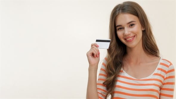 Thumbnail for Attractive Girl Showing Thumbs-up With Credit Card