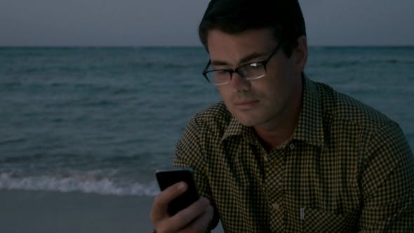 Thumbnail for Man Using Smartphone By The Sea