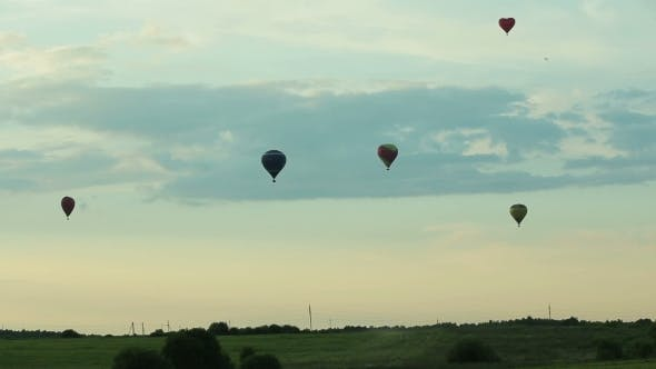 Thumbnail for Hot Air Balloons Flying Over Field In Countryside