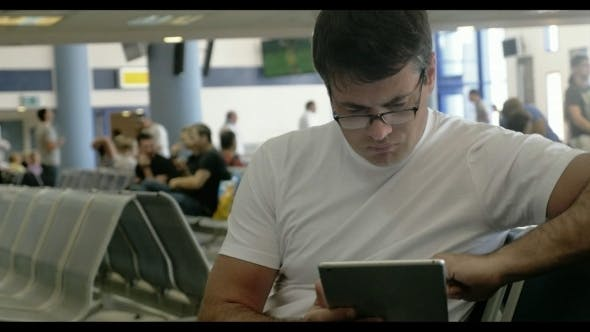 Thumbnail for Young Man Working With Touch Pad At The Airport