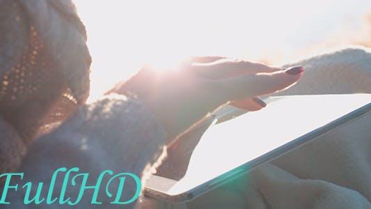 Thumbnail for Girl Using Tablet at Dawn