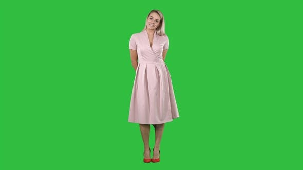 Thumbnail for Happy beautiful woman in pink dress posing on a Green Screen