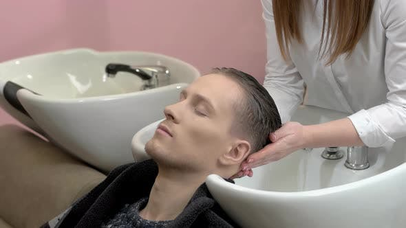 Man Getting His Head Washed