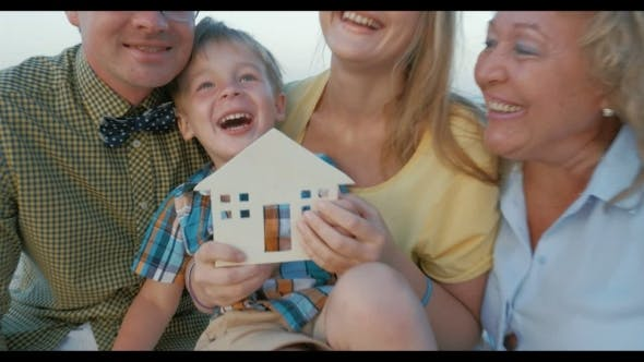 Thumbnail for Real Estate Concept With Happy Family