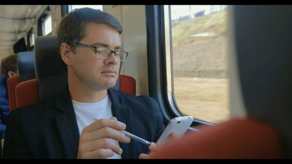 Thumbnail for Man With Cell Phone Enjoying View From The Train