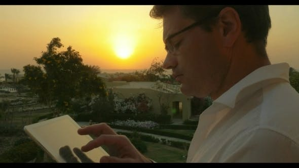 Thumbnail for Work On Business With Pad Outdoor At Sunset