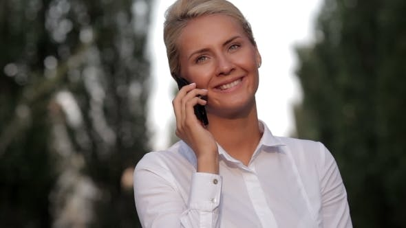 Thumbnail for Beautiful Lady Talking On Mobile Phone Outdoors