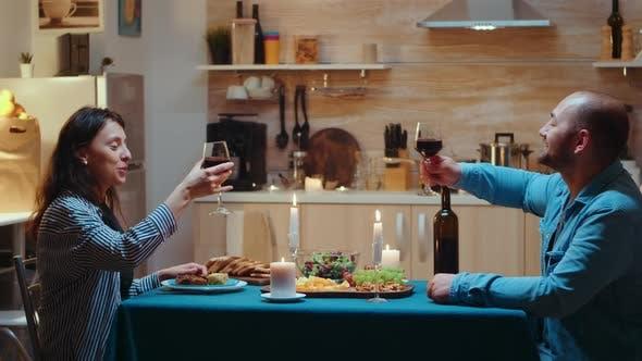 Couple Raising Wine Glass